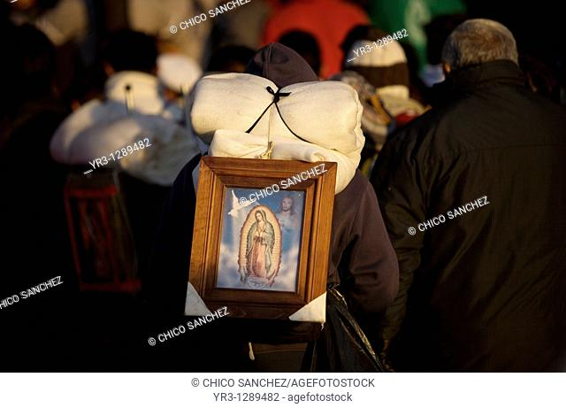 A pilgrim carries on his back an image of the Our Lady of Guadalupe outside of the Our Lady of Guadalupe Basilica in Mexico City, December 10