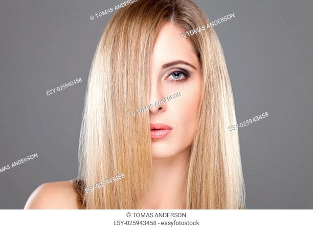 Portrait of an young blonde beauty with straight hair