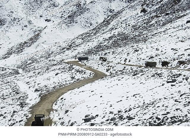 Military trucks moving through a mountain, Khardung La, Ladakh, Jammu And Kashmir, India