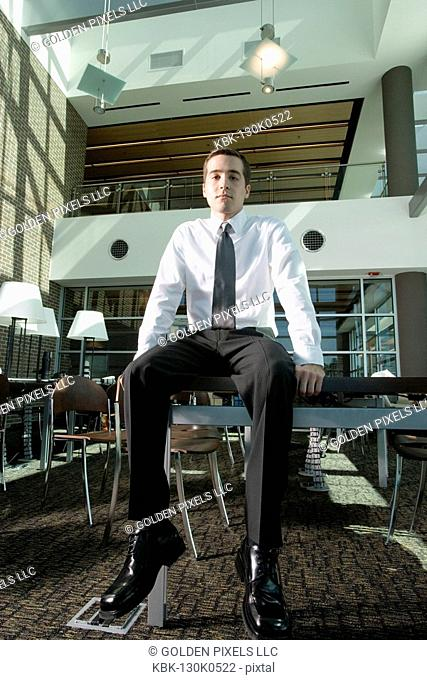 Office worker sitting on table