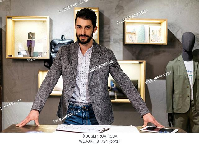 Portrait of confident man in menswear shop