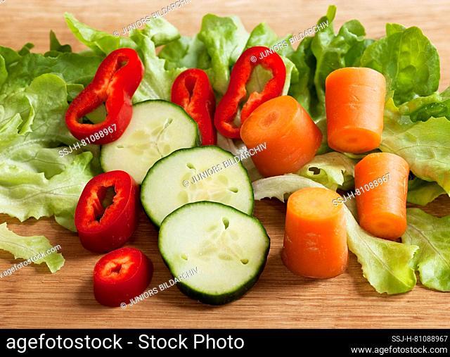 Sliced ?? vegetables (carrot, lettuce, bell pepper, zucchini)