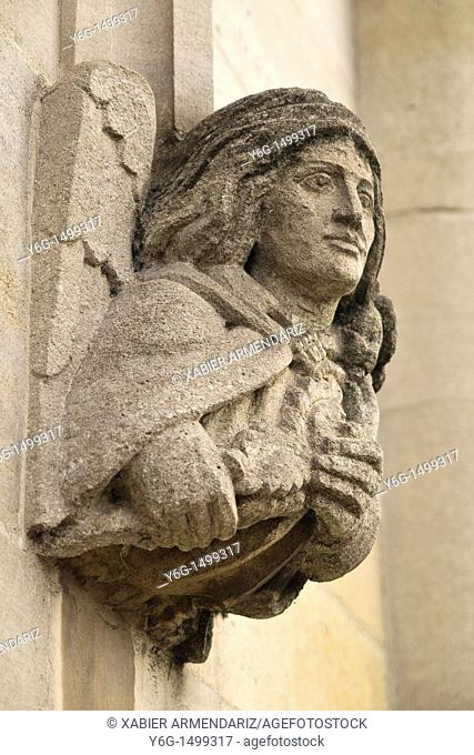 Angel stone figure in an old house of Oxford, England, Europe