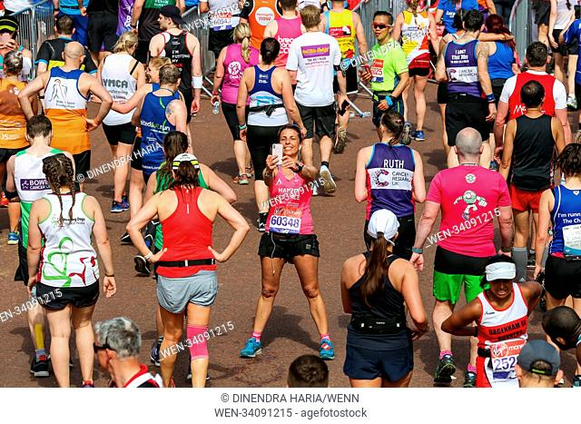 Runners at the finish line. Around 40,000 runners take part in the 38th London Marathon. The elites runners followed by thousands of club athletes, fun runners