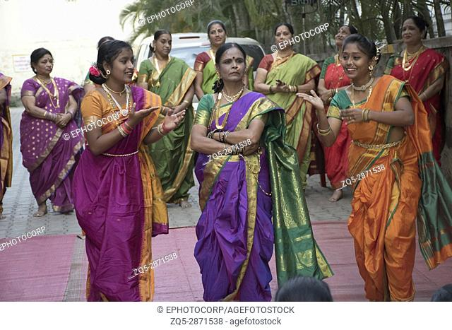Women dancing at baby shower ceremony