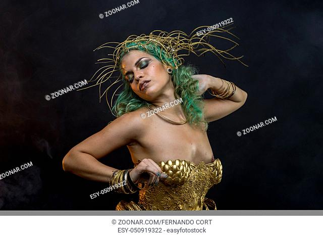 Fitness Latin woman with green hair and gold costume with handmade flourishes, fantasy image and tale