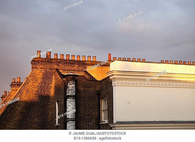 Chimneys on the top of a london's building in the afternoon light