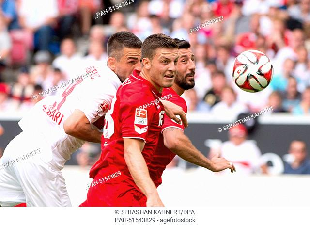 Stuttgart's Vedad Ibisevic (L-R) vies for the ball with Cologne's Kevin Wimmer and Dominic Maroh during the Bundesliga soccer match between VfB Stuttgart and 1