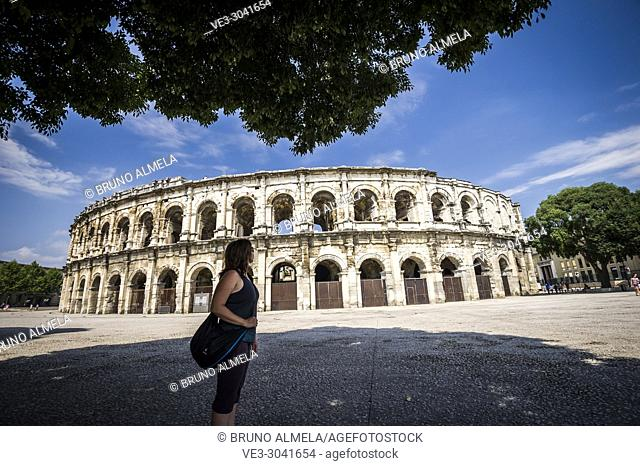 A young tourist in the roman Arena of Nîmes (department of Gard, region of Occitanie, France)