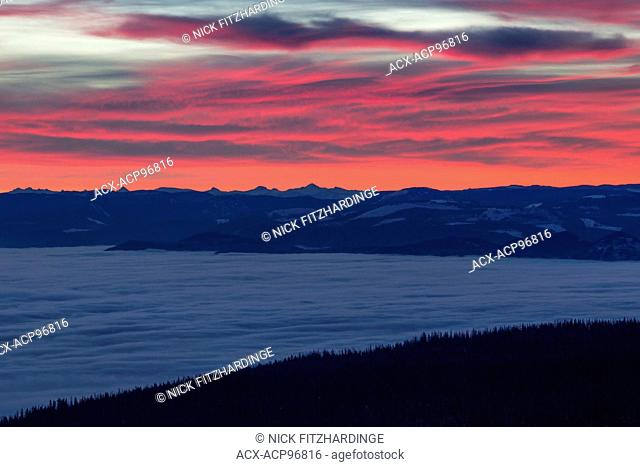 A red sunrise in winter viewed from Silverstar Provincial Park, British Columbia, Canada