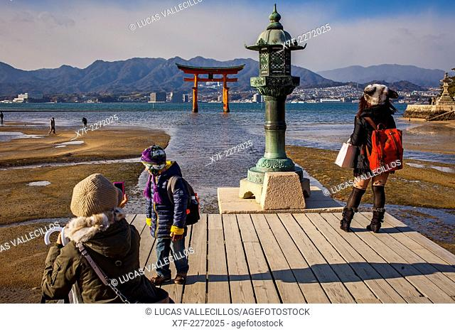 Visitors, Itsukushima Shinto Shrine complex, in background O torii Gate, the giant torii gate that is part of the Itsukushima Shinto Shrine complex
