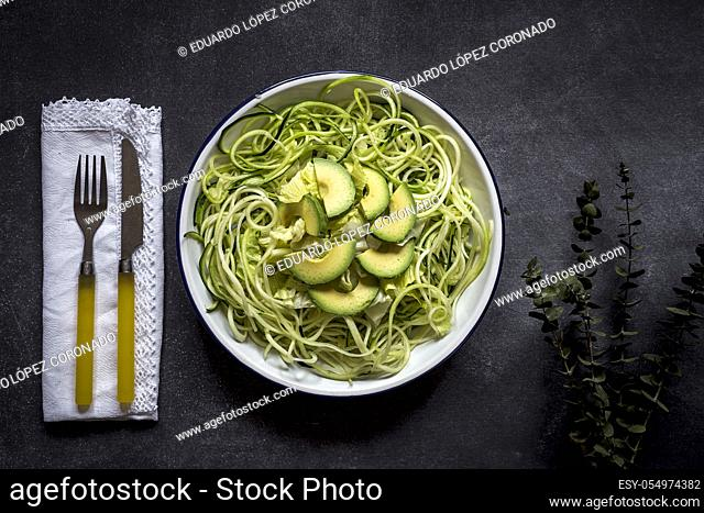 Fresh zucchini on a black background on old table