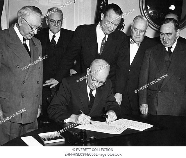 President Eisenhower signs House Joint Resolution 159. It authorized use of armed forces for protecting Formosa, and the Pescadores. Jan. 28, 1955