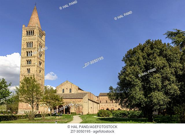 exterior view of ancient Romanesque abbey and huge bell tower, shot in bright spring sun light at Pomposa, Ferrara, Italy