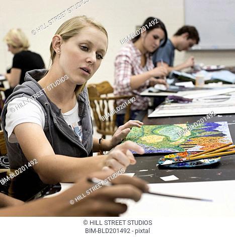 Caucasian student in art class