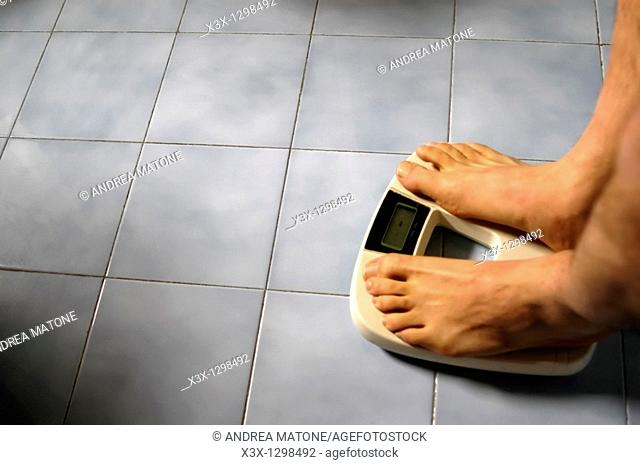 Man standing on a bathroom weight scale