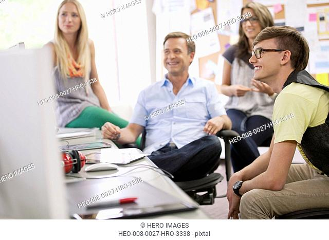 creative team in discussion in trendy office
