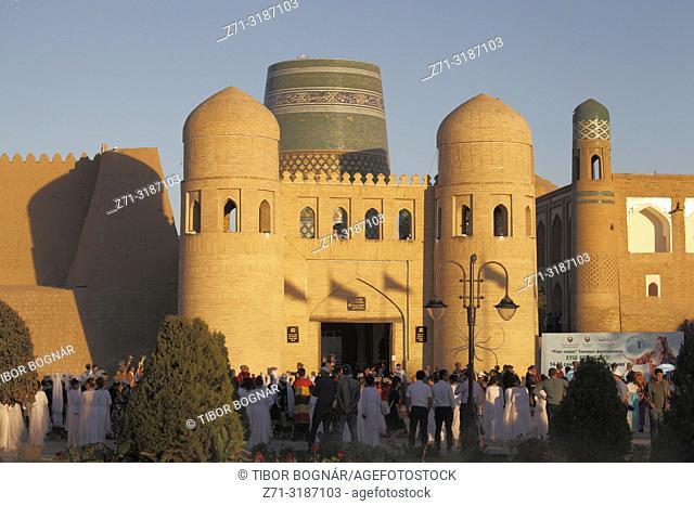 Uzbekistan, Khiva, West Gate, Kalta Minor Minaret, people,