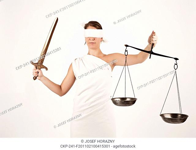 An illustrative photo of female model dressed as Justitia, Roman Goddess of Justice and the Legal System, in her hands she holds a sword and a pair of scales...