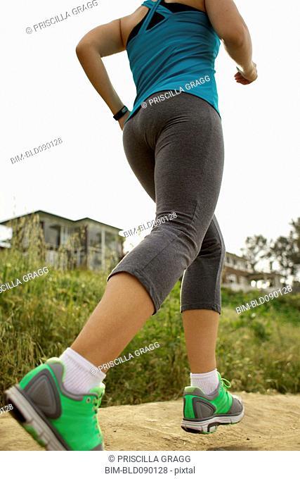 Mixed race woman running trail