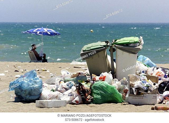 Garbage on a beach, Costa del Sol. Málaga province, Andalusia, Spain