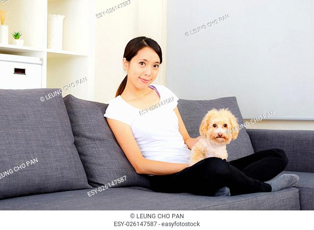 Asia woman and poodle at home