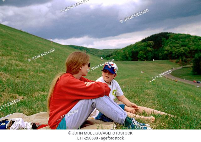 Mother and son talking at park