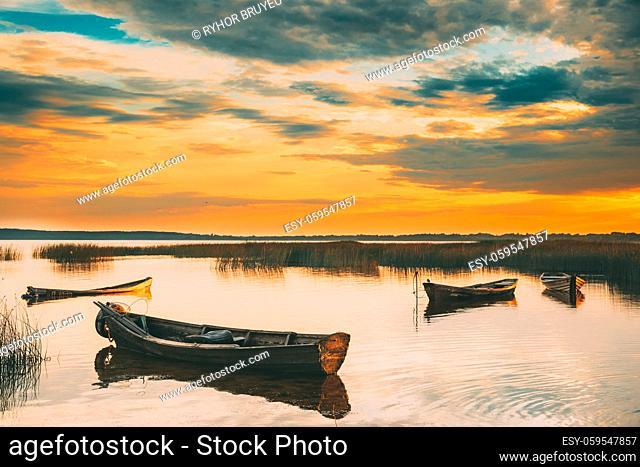Braslaw Or Braslau, Vitebsk Voblast, Belarus. Wooden Rowing Fishing Boats In Beautiful Summer Sunset On The Dryvyaty Lake