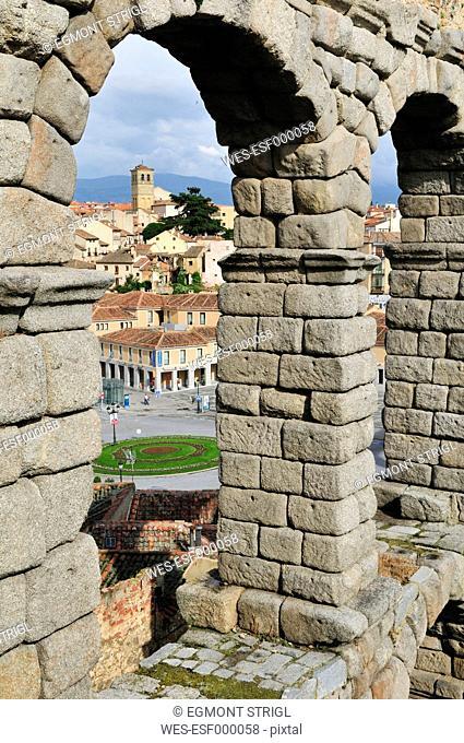 Europe, Spain, Castile and Leon, Segovia, View of cityscape through roman aqueduct