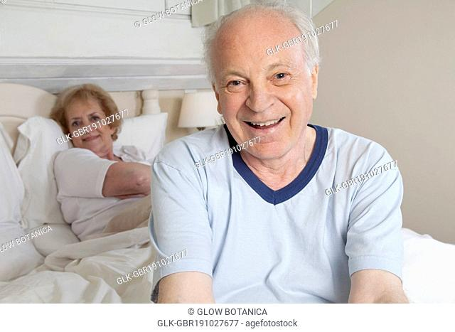 Couple smiling in the bed