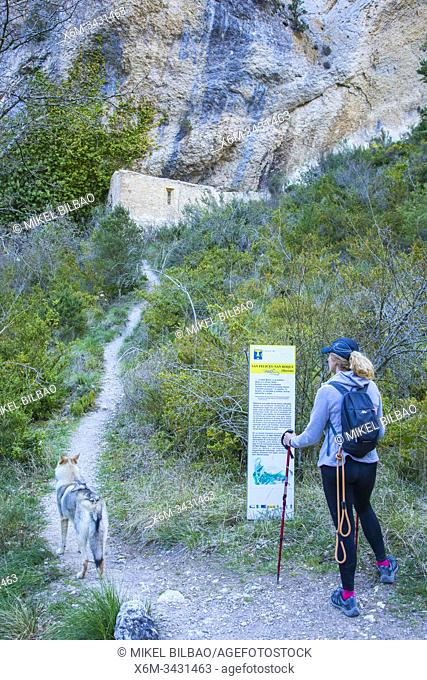 Woman hiker in a path. Desfiladero del Rio Puron route. Valderejo Natural Park, Alava, Spain, Europe