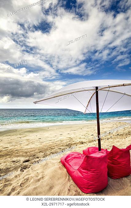 Bean bag chairs and umbrella for rent on White Sand Beach (Pantai Bias Putih). Manggis subdistrict, Karangasem Regency, Bali, Indonesia