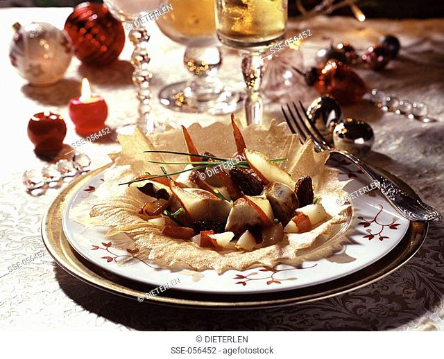 medallions of white sausage with pear and morels topic: christmas cooking