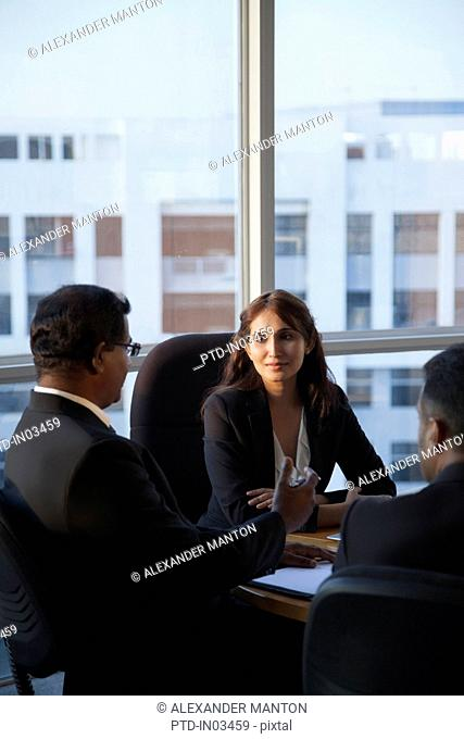 Singapore, Three business people talking at conference table