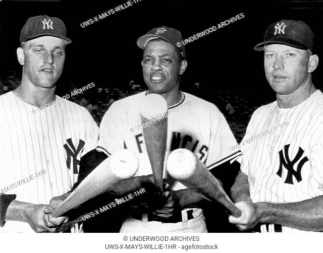 New York, New York: July 24, 1961.Slugging outfielders before an exhibition game at Yankee Stadium. L-R: Roger Maris, Yankees, Willie Mays, Giants