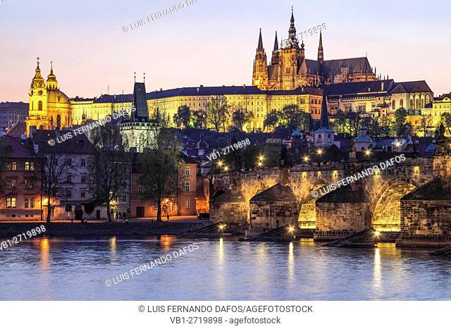 Charles Bridge, castle and cathedral lighted at dusk, Prague, Czech Republic