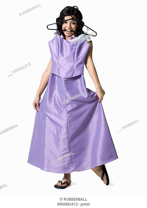 Teenage girl holding a dress
