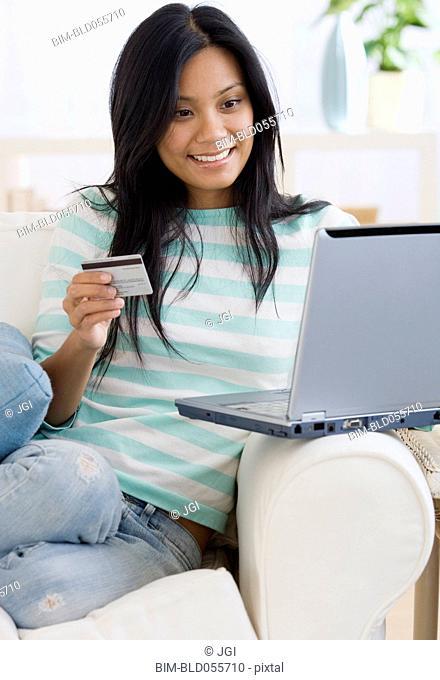Pacific Islander woman shopping online