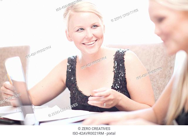 Businesswomen at conference table