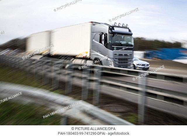 03 April 2018, Germany, Rodgau-Weiskirchen: A truck passes the service station Weiskirchen next to the A3 highway. Goal of the German Trade Union...