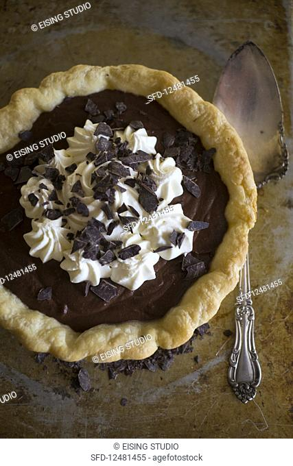 Chocolate pie with cream and chocolate shavings