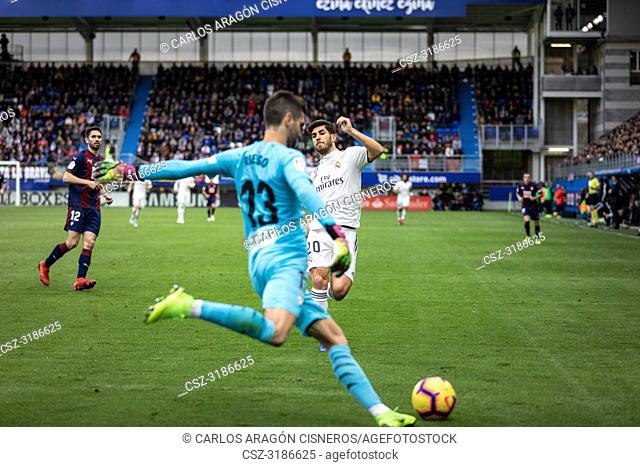Marco Asensio and Asier Riesgo dispute the ball during the La Liga match between Eibar and Real Madrid CF at Ipurua Stadium on November 24, 2018 in Eibar, Spain