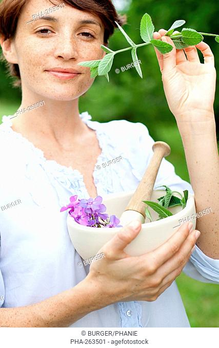 Woman picking plants come prepared to make an aromatic