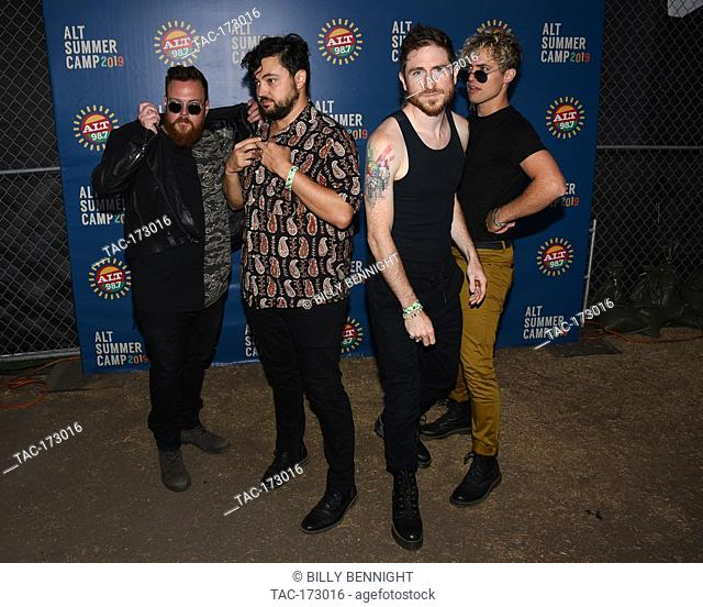Sean Waugaman, Nicholas Petricca, Eli Maiman and Kevin Ray of the band Walk the Moon pose for a portrait backstage ALT 98