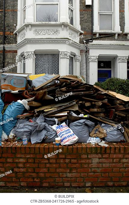 Renovation refuse outside a house, London, UK