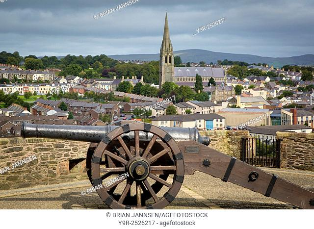Medieval cannon along the wall surrounding old Londonderry with St Eugene's Cathedral beyond, Londonderry/Derry, Northern Ireland, UK