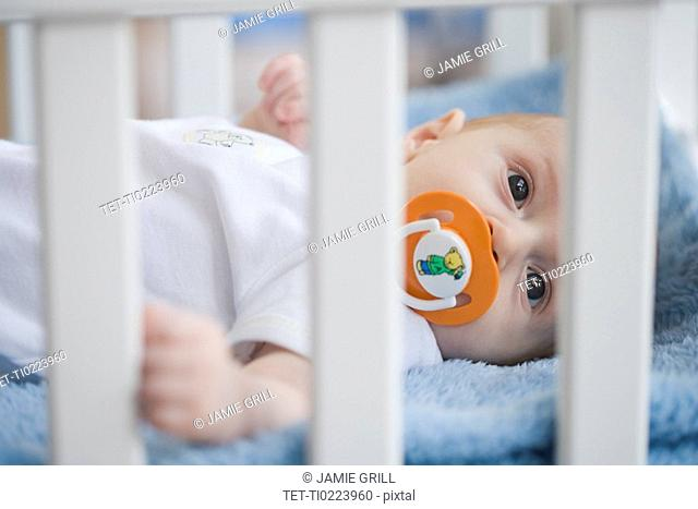Baby in crib with pacifier