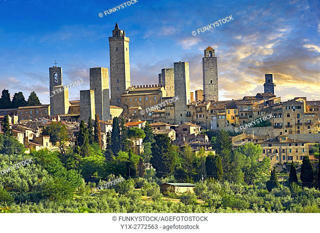 The 13th century medieval wall and towers of San Gimignano. Originally San Gimignano had 70 towers built for protection as a result of feuding families who...
