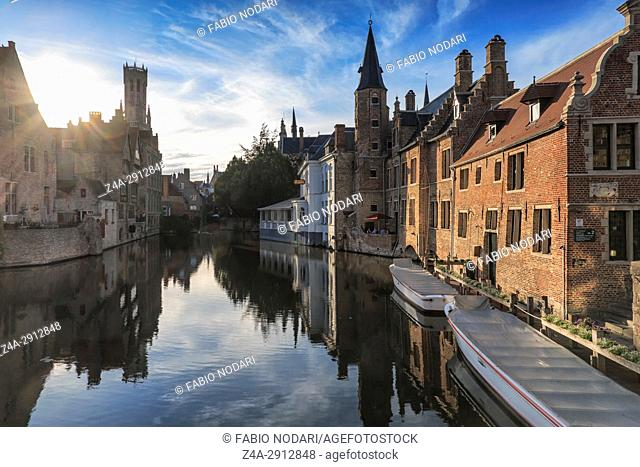 "Bruges, Belgium - July 7, 2017: Scenery with water canal in Bruges, """"Venice of the North"""", cityscape of Flanders, Belgium at sunset"