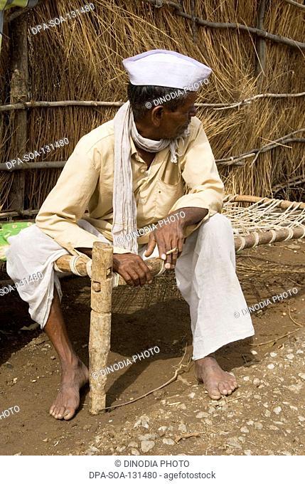 Man seating outside home ; Marathwada ; Maharashtra ; India